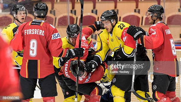 Brett Carson of SaiPa Lappeenranta giv Christopher Mastomäki of Lulea Hockey a slap in the face during the Champions Hockey League match between...