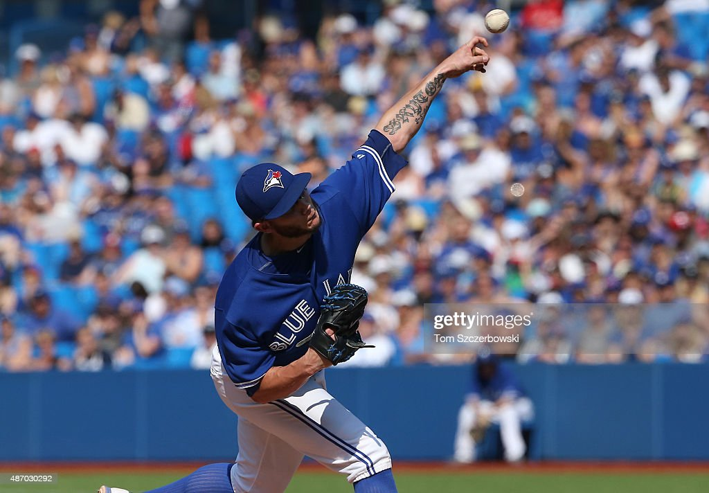 Brett Cecil #27 of the Toronto Blue Jays delivers a pitch in the ninth inning during MLB game action against the Baltimore Orioles on September 5, 2015 at Rogers Centre in Toronto, Ontario, Canada.