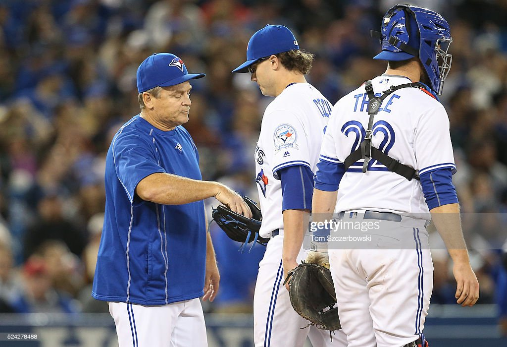 Brett Cecil #27 of the Toronto Blue Jays gives up the baseball as he is relieved by manager John Gibbons #5 in the seventh inning during MLB game action against the Chicago White Sox on April 25, 2016 at Rogers Centre in Toronto, Ontario, Canada.