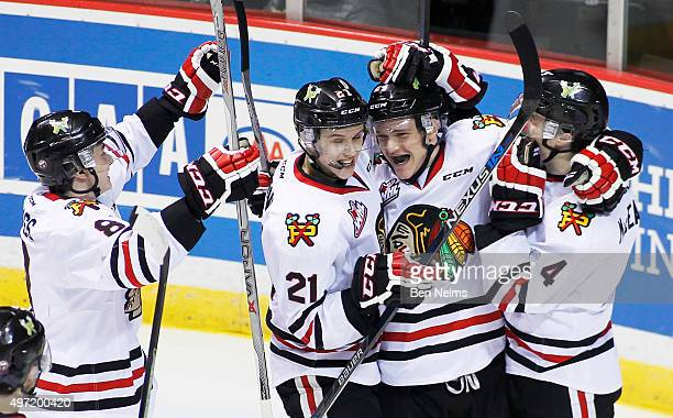 Brett Clayton of the Portland Winterhawks celebrates his goal against the Vancouver Giants with teammates Cody Glass Brendan De Jong and Conor...