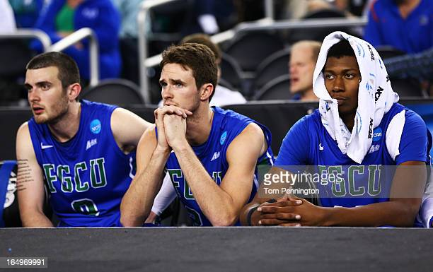 Brett Comer Eddie Murray and Eric McKnight of the Florida Gulf Coast Eagles look on late in their 62 to 50 loss ot the Florida Gators during the...