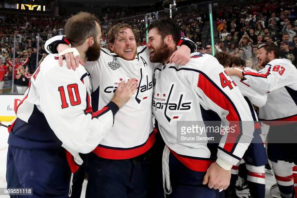 Brett Connolly Nicklas Backstrom and Tom Wilson of the Washington Capitals celebrate their teams 43 win over the Vegas Golden Knights in Game Five of...