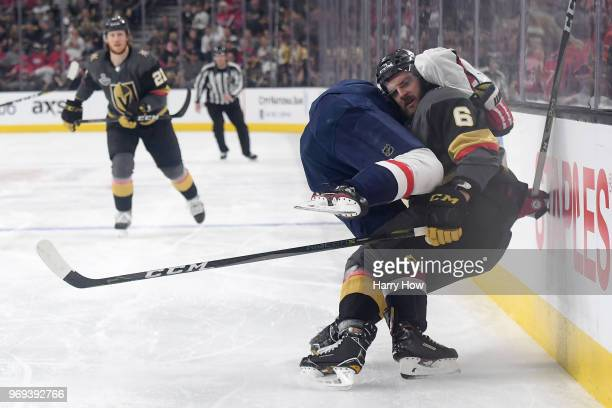 Brett Connolly of the Washington Capitals and Colin Miller of the Vegas Golden Knights collide along the boards during the second period in Game Five...