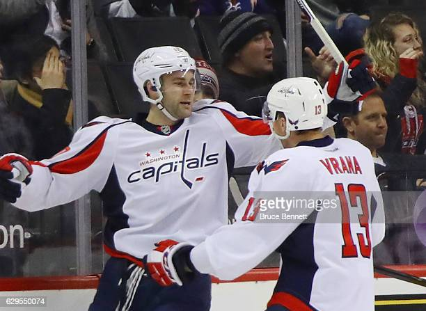 Brett Connolly of the Washington Capitals celebrates his goal at 209 of the second period against the New York Islanders and is joined by Jakub Vrana...