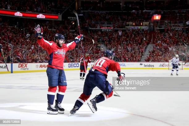 Brett Connolly of the Washington Capitals celebrates with his teammate Chandler Stephenson after scoring a goal on Andrei Vasilevskiy of the Tampa...