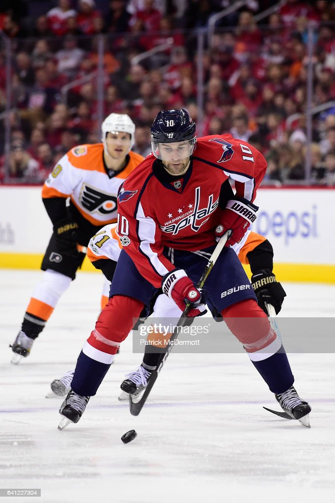 eca2ad73cfd Brett Connolly of the Washington Capitals skates with the puck in ...
