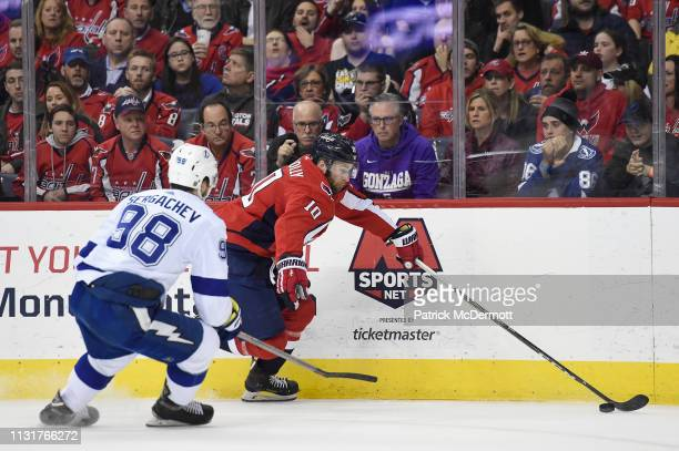Brett Connolly of the Washington Capitals skates with the puck against Mikhail Sergachev of the Tampa Bay Lightning in the first period at Capital...