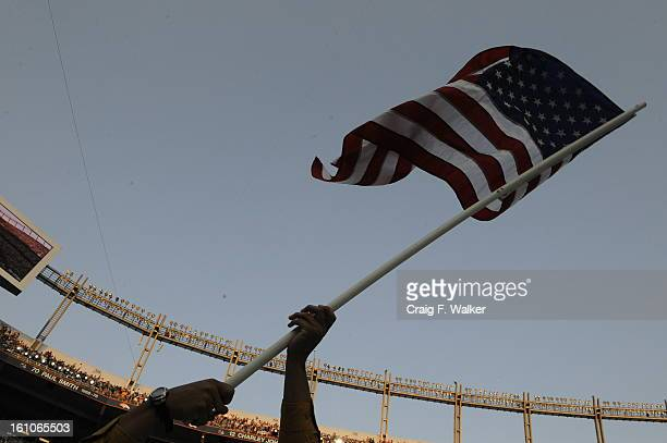 Brett Cooper of Arlington waves a flag during Al Gore's speech on the last day of the Democratic National Convention Thursday August 28 2008 at...