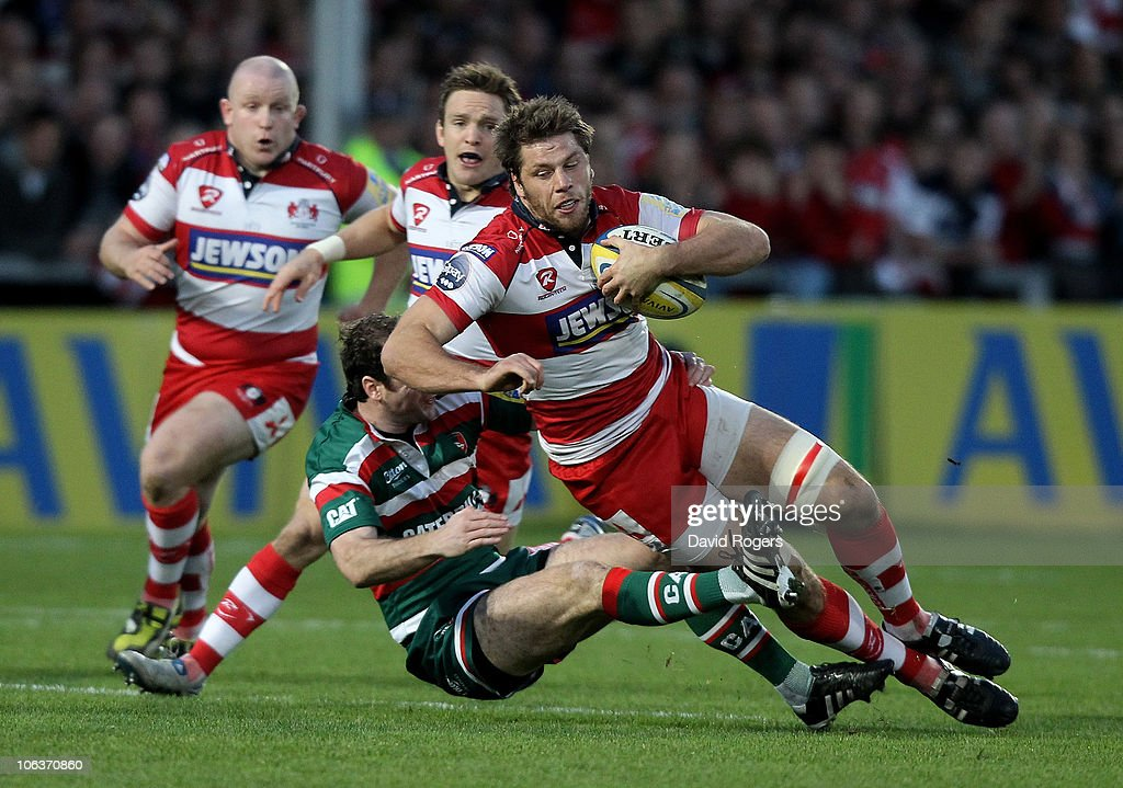 Brett Deacon of Gloucester is tackled by Geordan Murphy during the Aviva Premiership match between Gloucester and Leicester Tigers at Kingsholm on October 30, 2010 in Gloucester, England.