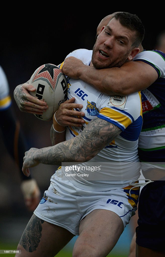 Brett Delaney of Leeds is tackled by Adam Sidlow of Bradford during Rugby League pre-season friendly between Leeds Rhinos and Bradford Bulls at Headingley Stadium on January 20, 2013 in Leeds, England.