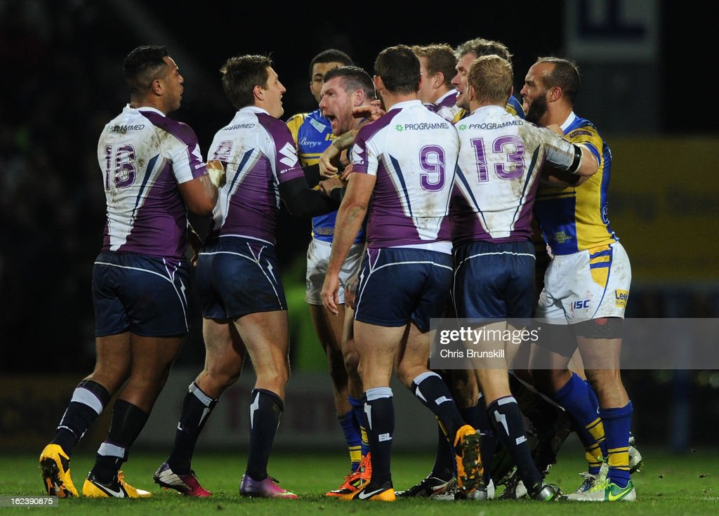 Brett Delaney of Leeds Rhinos clashes with Siosaia Vave of Melbourne Storm during the World Club Challenge match between Leeds Rhinos and Melbourne Storm at Headingley Carnegie Stadium on February 22, 2013 in Leeds, England.
