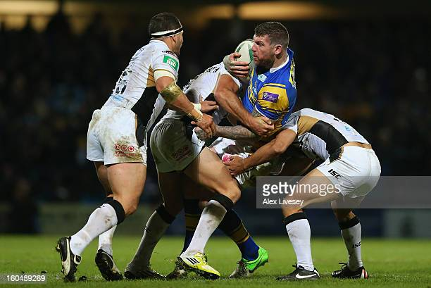 Brett Delaney of Leeds Rhinos is tackled by Daniel Holdsworth of Hull FC during the Stobart Super League match between Leeds Rhinos and Hull FC at...