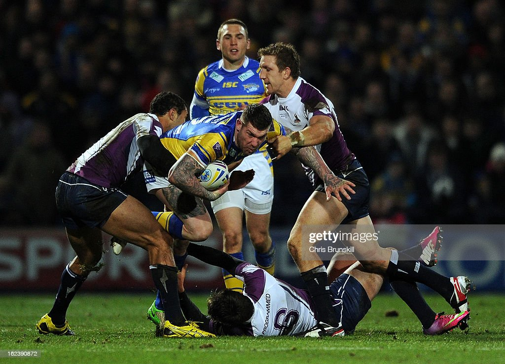 Brett Delaney of Leeds Rhinos is tackled by Gareth Widdop (C) and Justin O'Neill (L) of Melbourne Storm during the World Club Challenge match between Leeds Rhinos and Melbourne Storm at Headingley Carnegie Stadium on February 22, 2013 in Leeds, England.