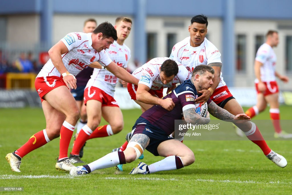 Brett Delaney of Leeds Rhinos is tackled during the BetFred Super League match between Hull KR and Leeds Rhinos at KCOM Craven Park on April 29, 2018 in Hull, England.