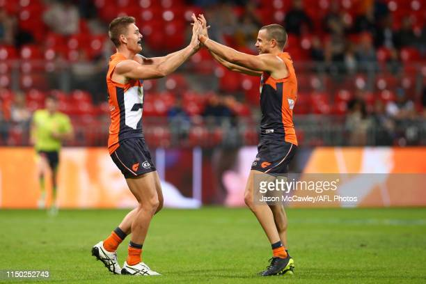 Brett Deledio and Adam Tomlinson of the Giants celebrate a goal during the round nine AFL match between the Greater Western Sydney Giants and the...