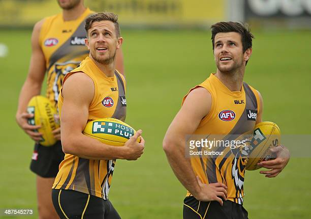 Brett Deledio and Trent Cotchin of the Tigers look on during a Richmond Tigers AFL training session at ME Bank Centre on May 1, 2014 in Melbourne,...