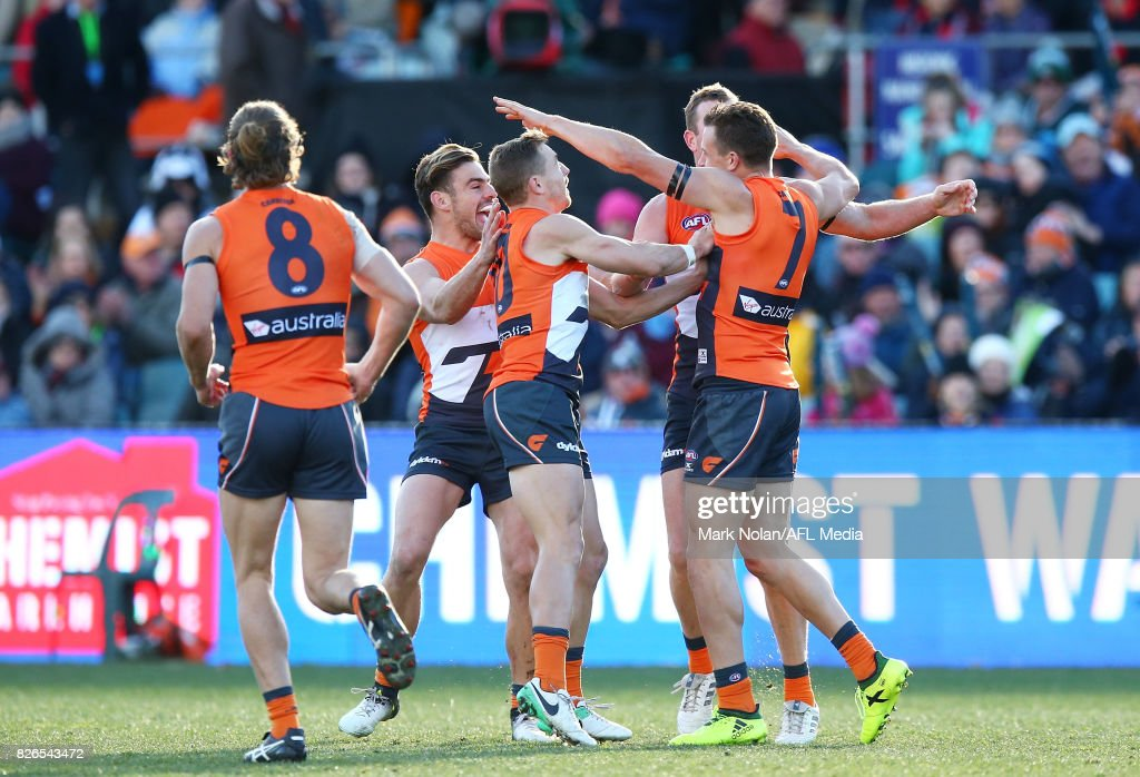 Brett Deledio of the Giants celebrates his first goal with team mates during the round 20 AFL match between the Greater Western Sydney Giants and the Melbourne Demons at UNSW Canberra Oval on August 5, 2017 in Canberra, Australia.