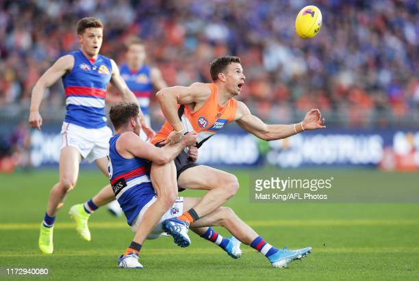 Brett Deledio of the Giants is challenged by Hayden Crozier of the Bulldogs during the AFL 2nd Elimination Final match between the Greater Western...