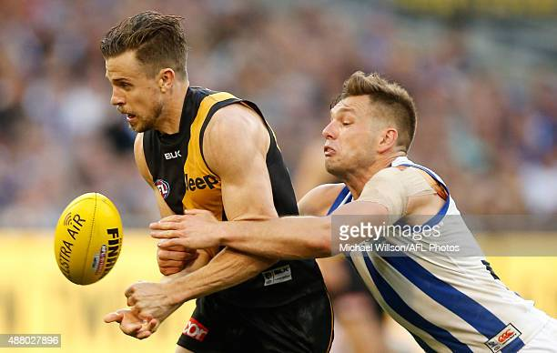 Brett Deledio of the Tigers is tackled by Shaun Higgins of the Kangaroos during the 2015 AFL First Elimination Final match between the Richmond...