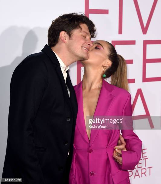 Brett Dier and Haley Lu Richardson arrive at the premiere of CBS Films' Five Feet Apart at the Fox Bruin Theatre on March 07 2019 in Los Angeles...