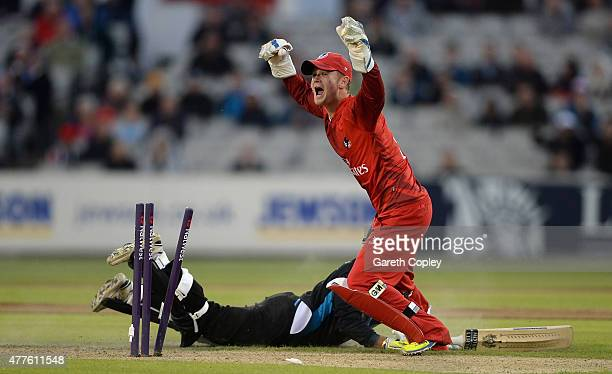Brett D'Oliveira of Worcestershire is run out by Lancashire wicketkeeper Alex Davies during the NatWest T20 Blast match between Lancashire Lighting...