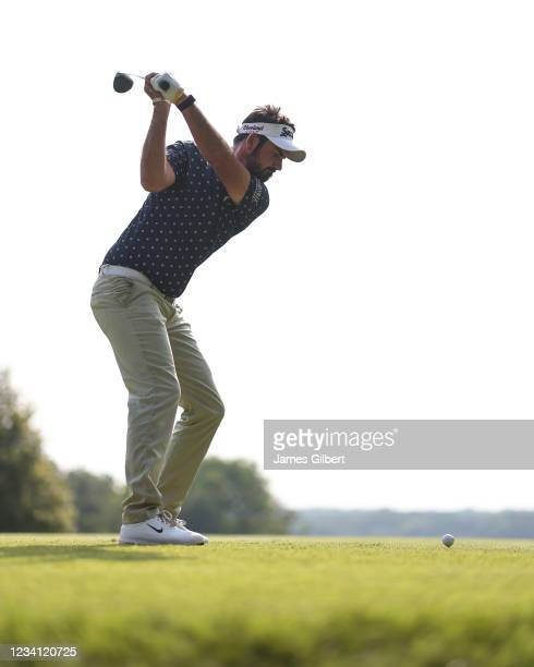 Brett Drewitt of Australia plays his shot from the 18th tee during the first round of the Price Cutter Charity Championship presented by Dr. Pepper...