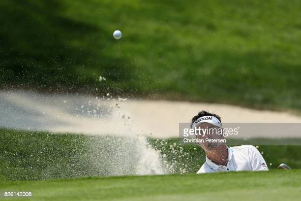 Brett Drewitt of Australia plays his shot out of the bunker on the fifth hole during the first round of the Barracuda Championship at Montreux...