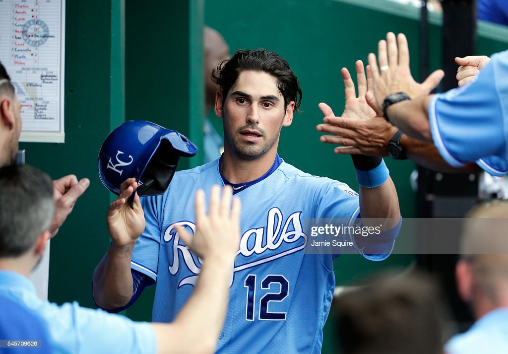Brett Eibner #12 of the Kansas City Royals is congratulated by teammates after scoring during the game against the Seattle Mariners at Kauffman Stadium on July 9, 2016 in Kansas City, Missouri.