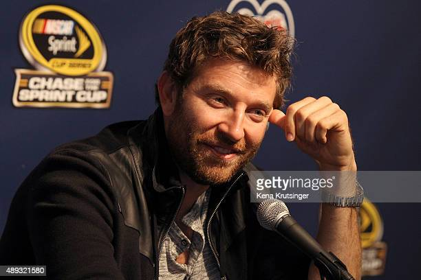 Brett Eldredge American country music singer speaks at a press conference prior to the NASCAR Sprint Cup Series myAFibRiskcom 400 at Chicagoland...