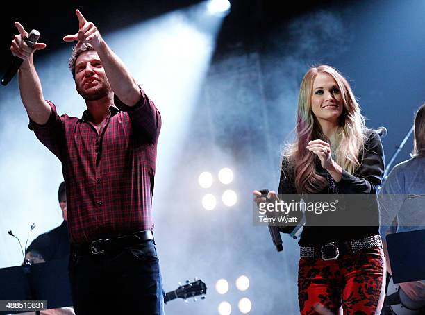 Brett Eldredge and Carrie Underwood perform on stage during Keith Urban's Fifth Annual We're All 4 The Hall Benefit Concert at the Bridgestone Arena...