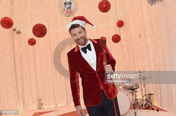 Brett Eldredge and Target give Nashville families both a trick and a treat to promote his Target exclusive holiday album Glow on October 31 2016 in...