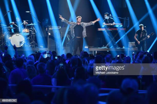 Brett Eldredge performs onstage during the 2017 CMT Music Awards at the Music City Center on June 6 2017 in Nashville Tennessee