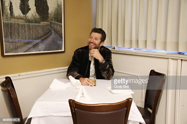 Brett Eldredge sits at Frank Sinatra's favorite table after performing on SiriusXM's The Highway channel at Patsy's Italian Restaurant on May 7 2018...