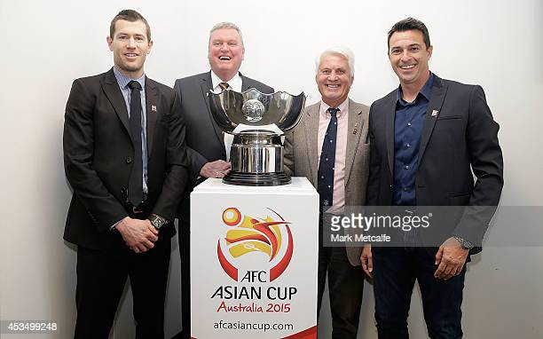 Brett Emerton Asian Cup LOC CEO Michael Brown Rale Rasic and Paul Okon pose with the Asian Cup Trophy during the AFC Asian Cup Ambassador...