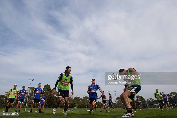 Brett Emerton heads the ball during a Sydney FC training session at Macquarie Uni on March 26 2013 in Sydney Australia