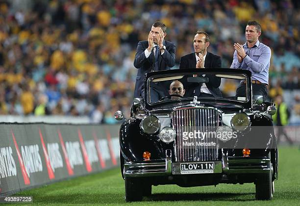 Brett Emerton Mark Schwarzer and Jason Culina are driven on a lap of honour during the International Friendly match between the Australian Socceroos...