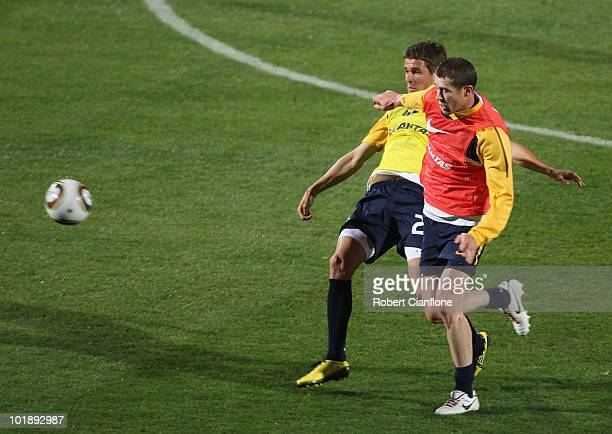 Brett Emerton of Australia is challenged by Dario Vidosic during an Australian Socceroos training session at Ruimsig Stadium on June 8 2010 in...
