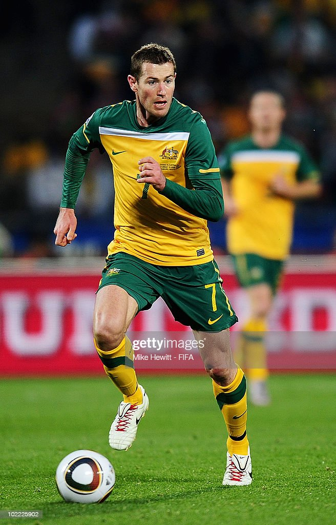 Brett Emerton of Australia runs with the ball during the 2010 FIFA World Cup South Africa Group D match between Ghana and Australia at the Royal Bafokeng Stadium on June 19, 2010 in Rustenburg, South Africa.