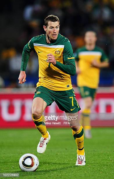 Brett Emerton of Australia runs with the ball during the 2010 FIFA World Cup South Africa Group D match between Ghana and Australia at the Royal...