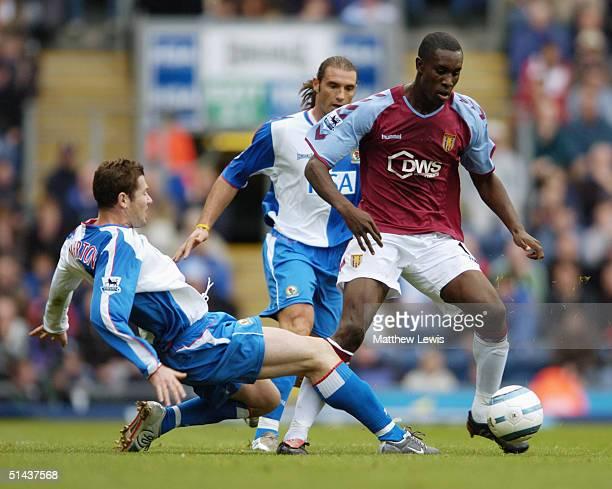 Brett Emerton of Blackburn Rovers tackles Carlton Cole of Aston Villa during the Barclays Premiership match between Blackburn Rovers and Aston Villa...