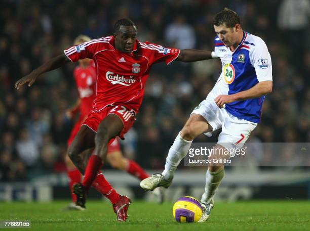 Brett Emerton of Blackburn Rovers tussles for posession with Momo Sissoko of Liverpool during the Barclays Premier League match between Blackburn...