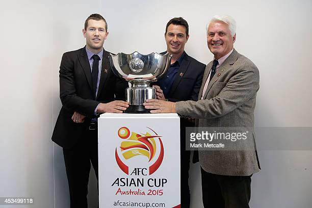 Brett Emerton Paul Okon and Rale Rasic pose with the Asian Cup Trophy during the AFC Asian Cup Ambassador Announcement at the LOC Offices on August...
