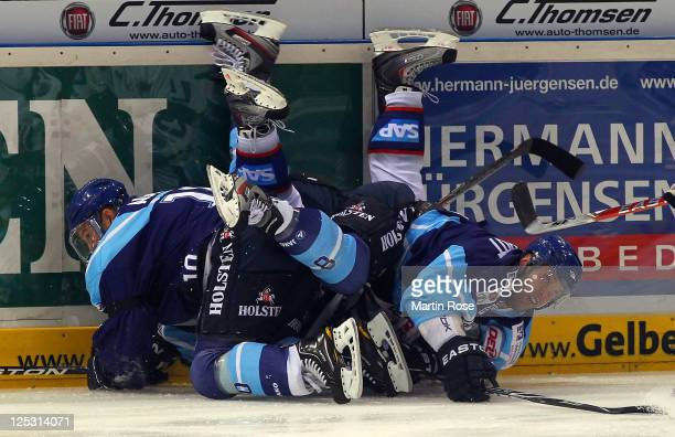 Brett Engelhardt of Hamburg clashes into the boards during the DEL match between Hamburg Freezers and Adler Mannheim at the O2 World Arena on...