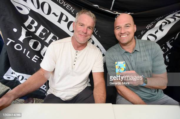 Brett Favre and Matt Hasselbeck let it go during Poo-Pourri's Giant Poo In Miami at The Wynwood Marketplace on February 01, 2020 in Miami, Florida.