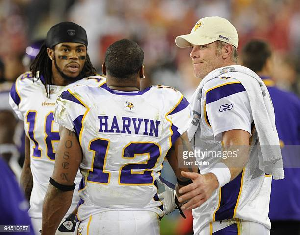 Brett Favre and Percy Harvin of the Minnesota Vikings talk on the sidelinesl during the NFL game against the Arizona Cardinals at the Universtity of...