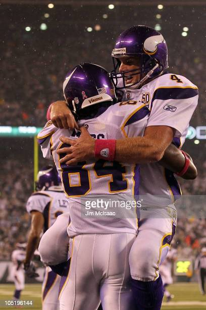 Brett Favre and Randy Moss of the Minnesota Vikings celebrate after Moss caught a 37-yard touchdown pass from Favre in the third quarter against the...