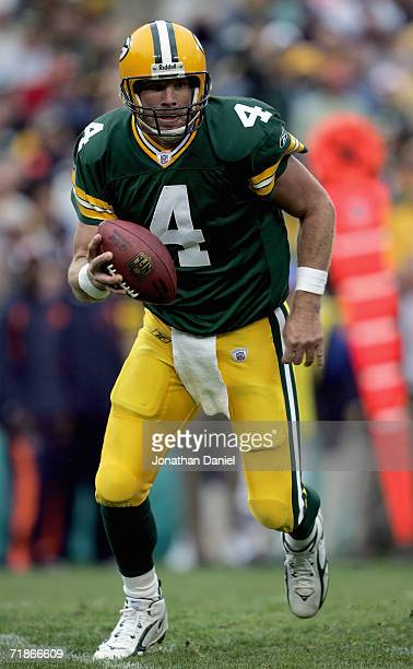 Brett Favre of the Green Bay Packers carries the ball during the game with the Chicago Bears on September 10 2006 at Lambeau Field in Green Bay...