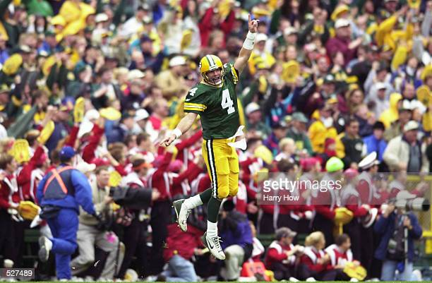 Brett Favre of the Green Bay Packers celebrates during the third quarter against the Baltimore Ravens during the game at Lambeau Field in Green Bay,...