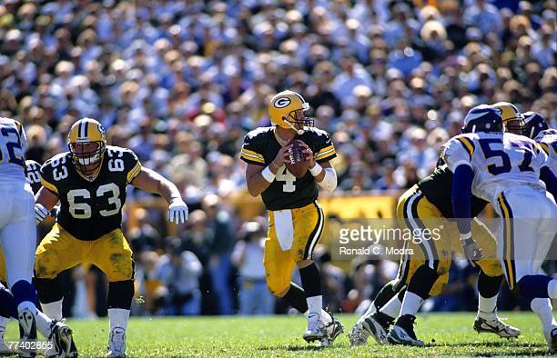 Brett Favre of the Green Bay Packers goes back to pass during a game against the Minnesota Vikings on September 21 1997 in Green Bay Wisconsin