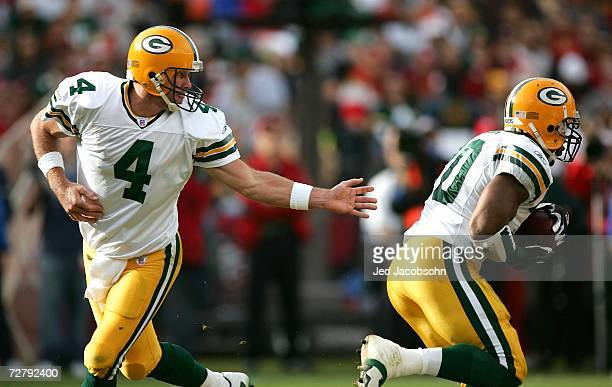 Brett Favre of the Green Bay Packers hands off the ball to Donald Driver during the NFL game against the San Francisco 49ers at Monster Park on...